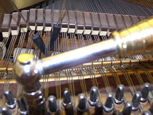 220px-Piano_Tuning_Hammer_and_Mutes.jpg